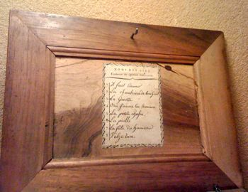 Lid of serinette, listing a Gavotte and other tunes